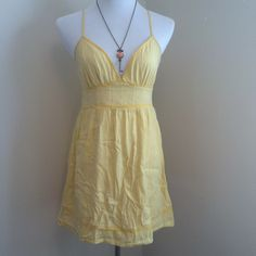 yellow sundress Perfect for the summer time!  Playful and flirty this dress can take you anywhere summer does!  There is a side zipper to make it easier to get on.  The eye from the hook and eye set is missing but the zipper should stay up fine!  The straps are adjustable to make it optimize fit! Forever 21 Dresses