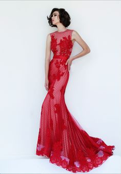 4325 in Red Stunning point d'esprit gown has strategically placed lace appliques, a thick horsehair hem, and satin lace belt which bows underneath the open keyhole back.