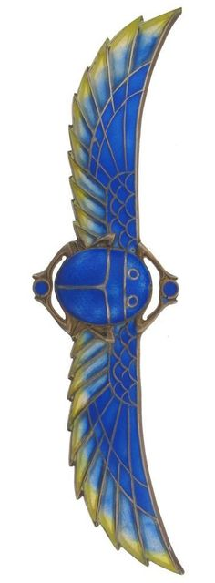 An Art Deco scarab brooch. The silver gilt scarab with enamel and plique-à-jour decoration.