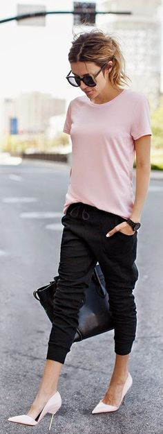 Black slim jogger pants, top pink tee, patent heels.