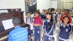 Children enjoying some music at the youth centre in Brazil