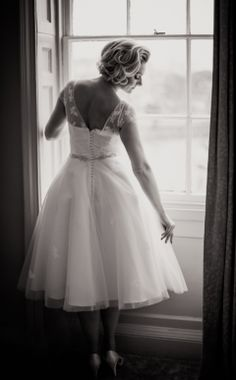 Short wedding dress. I'm not a fan of short wedding dresses, but I do like the elegance of this one.