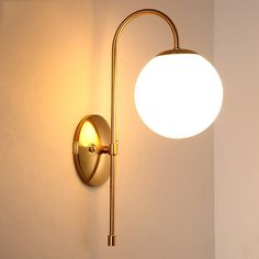 Minimalist Metal Curved Arm Aged Brass Single-Light Indoor Sconce with Round Bac. Minimalist Metal Curved Arm Aged Brass Single-Light Indoor Sconce with Round Backplate Bedside Lighting, Wall Sconce Lighting, Home Lighting, Wall Sconces, Lighting Store, Brass Wall Lights, Pendant Lighting, Bedroom Light Fixtures, Led Light Fixtures