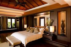 "Contemporary Master Bedroom with Ceiling fan, Window seat, 44"" Casa Vieja Rosetta Oil-Rubbed Bronze Ceiling Fan, Exposed beam"