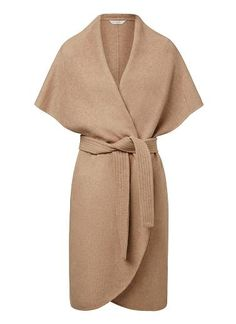 Wool/Polyester Sleeveless Wrap Coat. Comfortable oversized silhouette features a waterfall lapel with back hood and waist tie. Available in Light Caramel as shown.