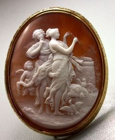 "Amazing Cameo Scene of the Goddesses Venus and Diana - I love all the detail & activity going on in this cameo.  Cherub?✓  Birds?✓ Flowers? ✓ Cherub-encrusted architectural thing? ✓   ت Sardonyx shell, 15k gold tested.  The brooch is 2⅝"" by 2⅛""; the cameo alone is 2¼"" by 1¾"".  Circa 1860 Italy.   [Don't miss Giovanna Di Rosa's great discussion of this piece on the original site.]  $4,500.00"