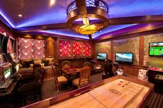 A #game #room that uses rich burgundy and browns to re-create a lounge or casino environment