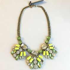 J.crew Neon Crystal and Brass Necklace J.crew Neon Crystal and Brass Necklace. Gorgeous J.Crew necklace in shades of neon yellow, clear and green colored stones. This is brand-new with tags attached. Comes with the J.Crew jewelry bag. This is from the J.Crew store. **Please note that photo number two shows a missing stone in the center cluster. Only missing the one and can likely be replaced, I just never got around to it. J. Crew Jewelry Necklaces