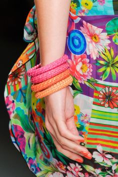 THE TOP GLOBAL MANICURES FOR SPRING 2013: Caroline Charles's team went with an electric tangerine shade that blended well with the bright fabrics featured in her Spring 2013 lineup.