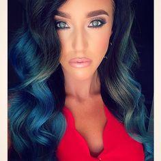 Wavy, blue hair and piercing, blue eyes