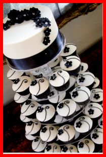 Black and White Cupcake Wedding Cake. I'd use silver wrappers and probably a green stem for my wedding