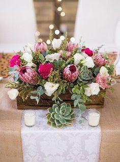 rustic succulent and pink protea with wooden box wedding centerpiece