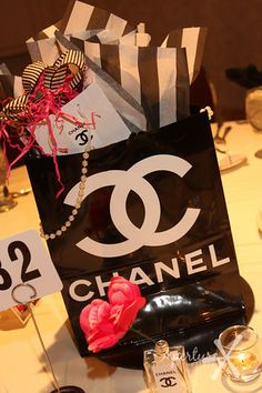 Centerpiece idea created for a fashion show recently. (Chanel based theme)