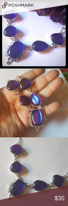 Beautiful 925 Rainbow Topaz Necklace This is a very pretty 925 Purple and Blue Rainbow Topaz Necklace. Changes colors with light and movement. Brand new. Jewelry Necklaces