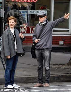 Bowie's personal assistant Corinne Coco Schwab (seen with Bowie in 2012) is receiving $2mi...