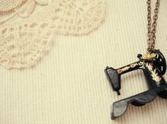 a vintage sewing machine necklace