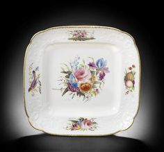 A rare Nantgarw square dessert dish, circa 1818-20 Of Brace service type, decorated in London in the Bradley workshop with a full central flower spray, including rose, chrysanthemum, bluebell and a finely painted iris, the C-scrolled borders with a bird on a branch, a spray of fruit, a flowering rosebush and another floral spray,