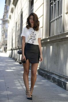 A white and black graphic crew-neck tee and a black leather mini skirt are a great outfit formula to have in your arsenal. Polish off the ensemble with black studded leather pumps. Shop this look on Lookastic: https://lookastic.com/women/looks/crew-neck-t-shirt-mini-skirt-pumps/11310 — White and Black Print Crew-neck T-shirt — Black Leather Mini Skirt — Black Leather Crossbody Bag — Black Sunglasses — Black Studded Leather Pumps