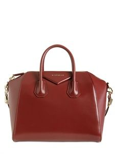 """#Mr_Whitty says : Do it like a lady. GIVENCHY . Architechture lipstick red. It says """"I am a woman. Yes this bag is red and I'm damn sexy with it."""" All in a shape."""