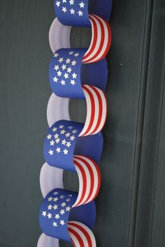 Your preschooler can help you decorate for the 4th of July BBQ by creating a paper-chain!