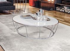 Contemporary coffee table with a round glass top in choice of black, white or beige