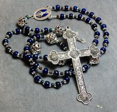 SALE  Blue Lapis Rosary Cable Silvered Cross and center small Crucifix Bali Bead Paters HeartFelt Rosaries HeartFeltRosaries by HeartFeltRosaries on Etsy https://www.etsy.com/listing/234382195/sale-blue-lapis-rosary-cable-silvered