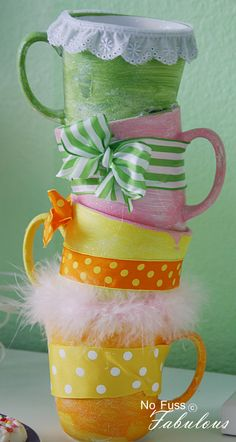 Stacked tea-cups wrapped in bows and lace, such a cute idea @Candace Renee Novielli Del Pozzo