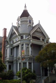 Huge Haas-Lilienthal House, San Francisco.  Cute upper floor balcony, windows around the tower, great architectural detail all over.  Why, oh why, make it hide behind an allover gray?