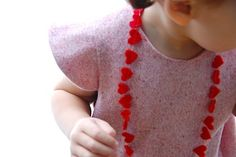 """Felt heart necklace. (Note: Recently purchased our daughter a """"poodle skirt"""" - an impulse after having been gone from the house too long. She loves it...and, it is made of felt. Felt is so easy to work with. Handmade poodle (or Cinderella) skirts for a little girl's party? That's our idea."""