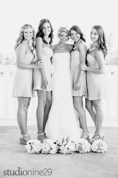 Putting the flowers at your feet then having your arms around one another makes it seem less staged and posey. Great ideas for photos!