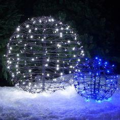 """24"""" lighted spheres feature blue LED string lights and they fold flat for convenient storage! Hang Christmas light balls from tree branches or place them in the front yard paired with other sizes and colors! http://www.christmaslightsetc.com/p/24--Hanging-light-sphere-150-Blue-LED-Lights-61758.htm"""