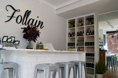 Follain.. Instead of besta, make a bar and hide filing cabinets and shelves beneath...put the TV where the lettering is.