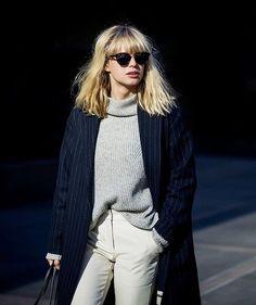 light gray turtleneck sweater, navy pinstripe trench, light cream chinos   black sunglasses
