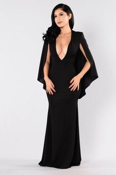 - Available in Black and Burgundy - Maxi Dress - Cape Overlay - Deep V Neckline - 95% Polyester, 5% Spandex