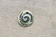 Ceramic pendant, glazed pendant, abstract pendant, spiral pendant, ceramic disc by BlackRabbitCeramics on Etsy Porcelain Clay, White Porcelain, Ceramic Pendant, Spiral, Buy And Sell, Pendants, Beads, Abstract, Handmade