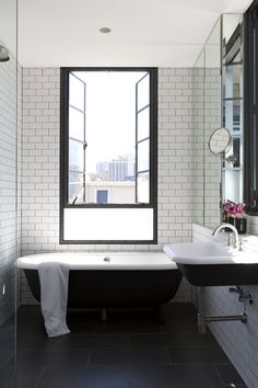 Like bath under window, black window, black and white bath, metro tiles, sink wall hanging - in fact love it all! Gallery | Australian Interior Design Awards