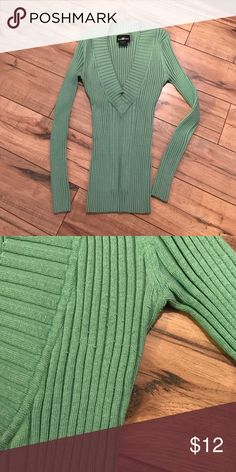 Pale green sweater Warm and very stretchy. V-neck. Looks very skinny in picture due to stretch capacity. It recoils when not being worn. So soft and comfortable. Great fall/winter sweater. Only slight pilling around armpits, otherwise in excellent condition. No other defects that I can see. From non-smoking home. It's Our Time Sweaters V-Necks