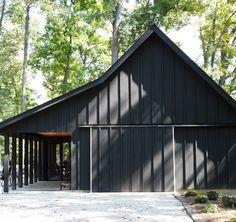 Black barn with black trim