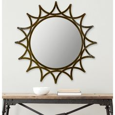 Add an upscale look to your home or office space with this gorgeous round decorative mirror. Featuring a hint of Mayan inspiration, this piece offers a beautiful hand-forged iron frame with a sun-like aesthetic and stunning amber finish.