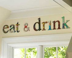 magazine pages glued to wooden letters in the kitchen!!