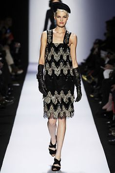 Diane Fall/Winter 2009. Diane's dress has style lines and concepts that were adopted from the 1920's flapper girl style. The drop waist and the detailed beading of this dress date the styles back to the 1920's. Also, the boxy shape knee length hem of the dress are styles adopted from the 20's.  4/2/15