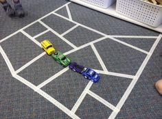 Masking tape roads for transportation center preschool.