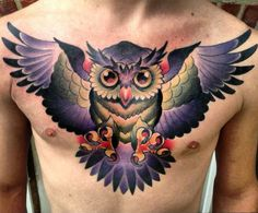 """A chest tattoo of an owl with a wow effect! Owls are often considered as symbols of wisdom and intelligence, since they are nocturnal there is a quality of mystery around them and they have been great favorites in Traditional Old School Tattoos. Same bird, different technique though, in New School Tattoos the bold outlines become finer if there are any outlines at all and shading evolves allowing light be captured in such a way that the eyes of this owl looks """"glassy""""."""