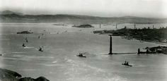 In this photo, the towers had been built but the cables had not yet been spun when the Pacific Fleet steamed through the Golden Gate Straight on May 3, 1935. Photo courtesy of the Golden Gate Bridge, Highway and Transportation District.