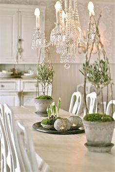 Gorgeous white décor.  Shabby chic furniture contrasts with crystal chandelier.