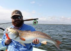 """Bull #redfish on a #2wt fly rod!  Matt with a 31"""" inch redfish caught and released on the Texas Laguna Madre.  Host: @ilive2fish  #southtexas #vivacc #corpuschristi #igtexas #flyfishing #ankonaboats by instagramtexas"""
