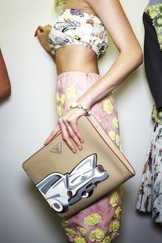 Rev it up with mixed prints & a traffic-stopping clutch.