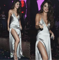 Selena Gomez wearing silk silver slip dress at an event