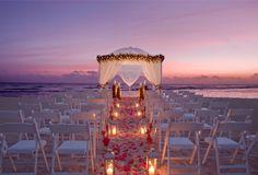 Wedding on the beach at night.
