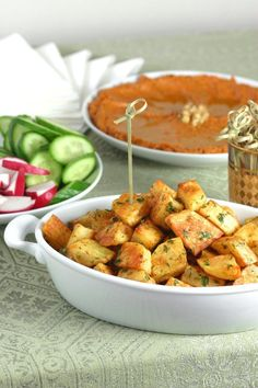 An easy to make recipe for Spicy Lebanese-Style Potatoes (Batata Harra). These spiced potatoes make a flavorful appetizer, side dish, or party snack.